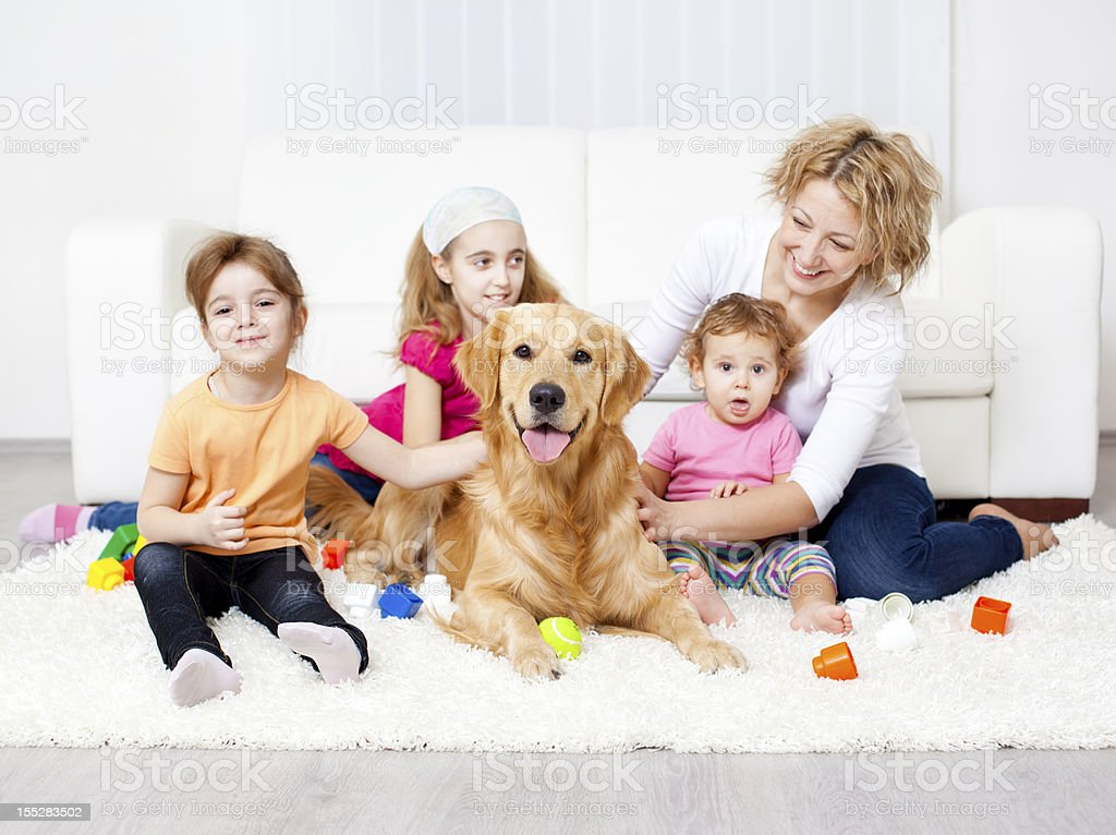 Family enjoy with Retriever at home. royalty-free stock photo