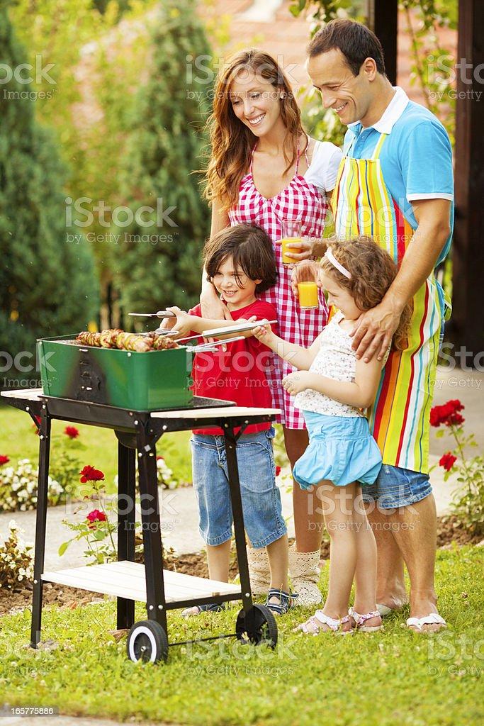 Family Enjoying a barbecue. royalty-free stock photo