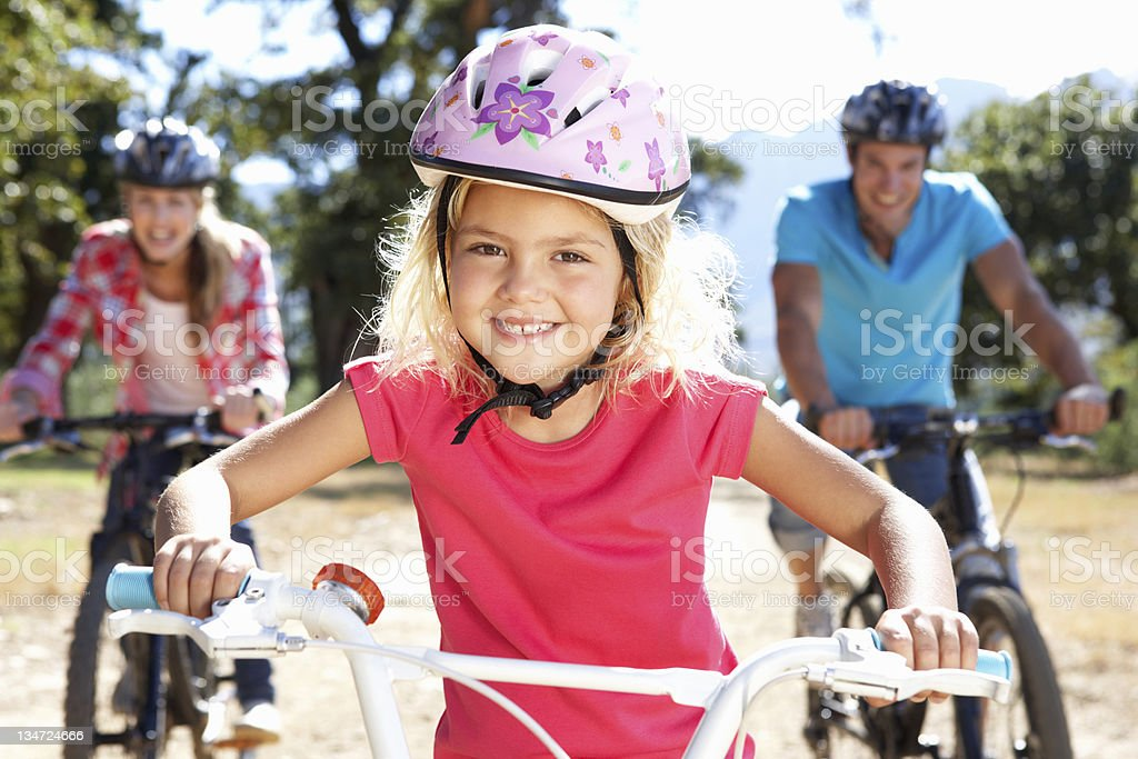 A family enjoying a bike ride together stock photo
