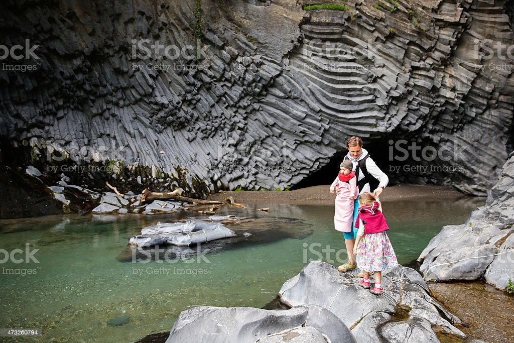 Family enjoying adventure in Golle del Alcantara gorge stock photo