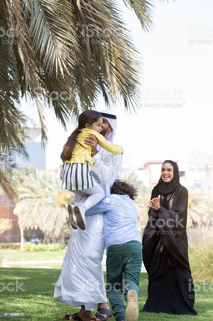 Family enjoying an afternoon outdoors in Dubai stock photo