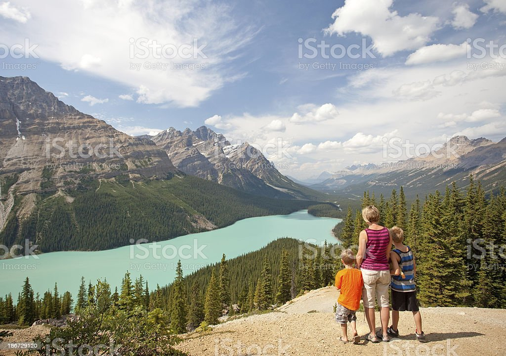 Family Enjoying Beautiful Mountain Lake stock photo