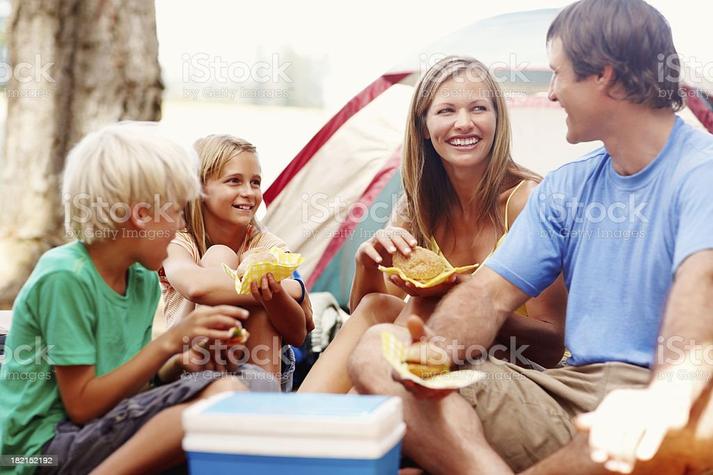 Family enjoying breakfast while camping royalty-free stock photo