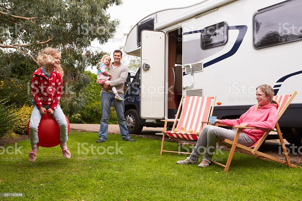 Family Enjoying Camping Holiday In Camper Van stock photo