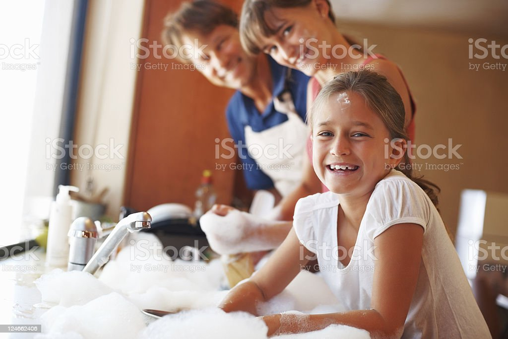 Family enjoying dishwashing royalty-free stock photo