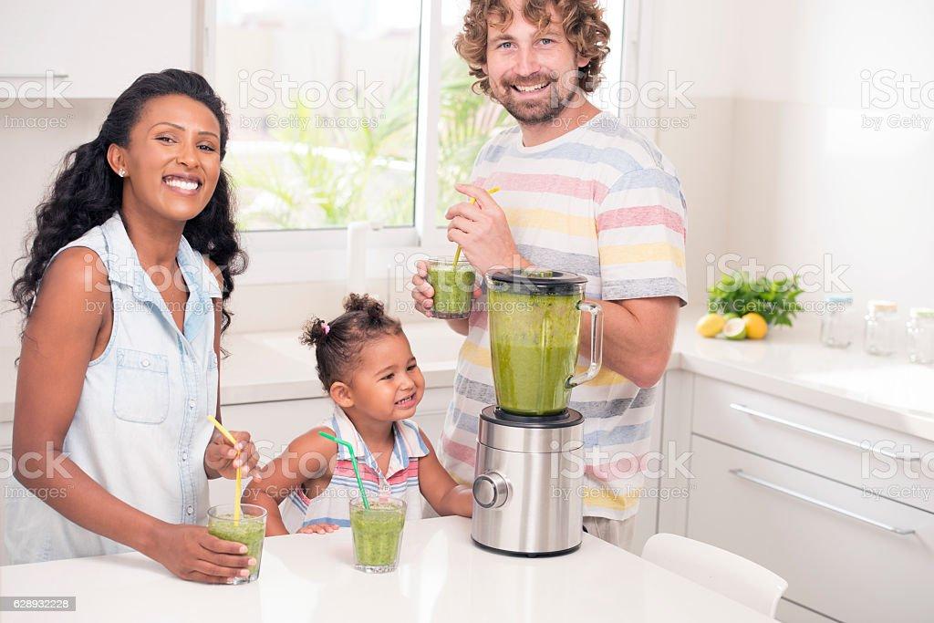 Family enjoying fresh drink. stock photo