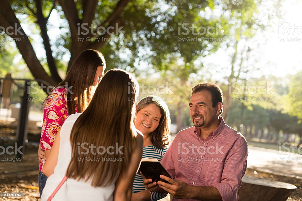 Family enjoying in park stock photo