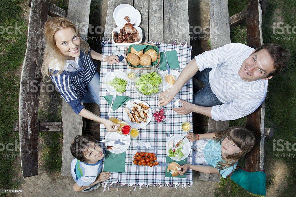 Family enjoying in picnic royalty-free stock photo