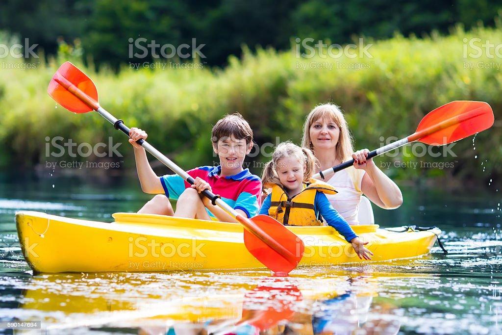 Family enjoying kayak ride on a beautiful river stock photo