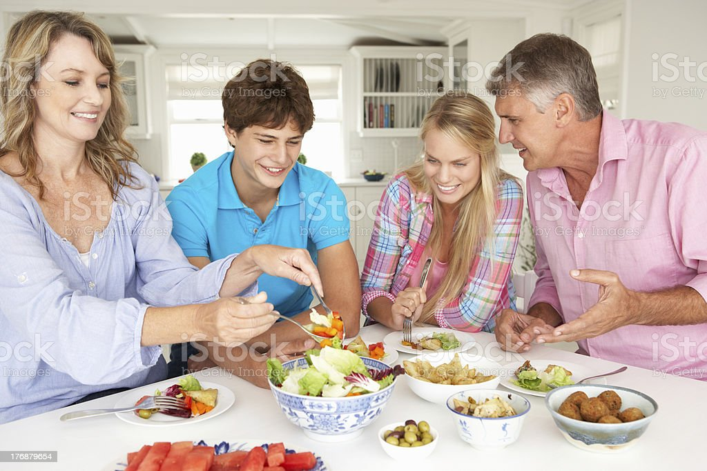 Family enjoying meal at home royalty-free stock photo