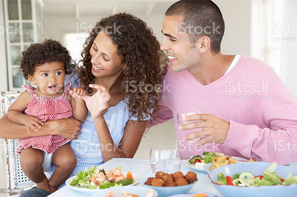Family Enjoying Meal Together At Home royalty-free stock photo