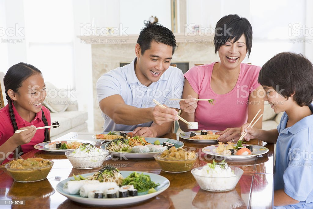 Family Enjoying Meal Together stock photo