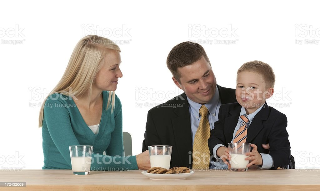 Family enjoying milk with cookies royalty-free stock photo