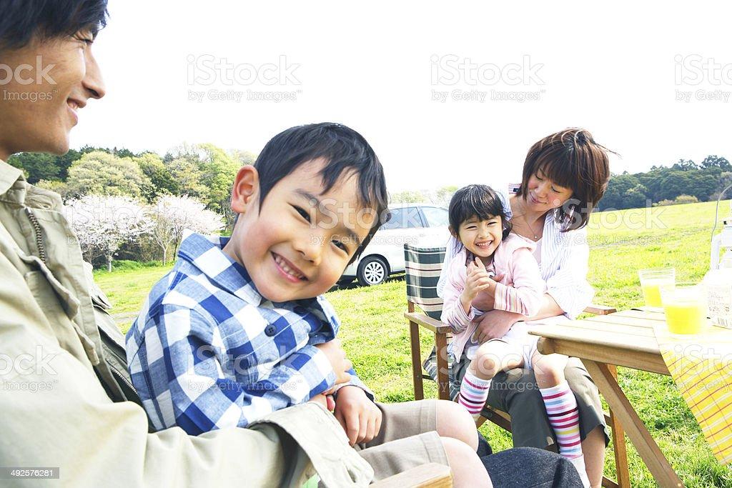 Family enjoying picnic in prairie royalty-free stock photo