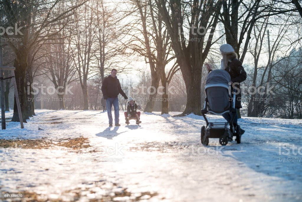 Family enjoying sunny winter days stock photo
