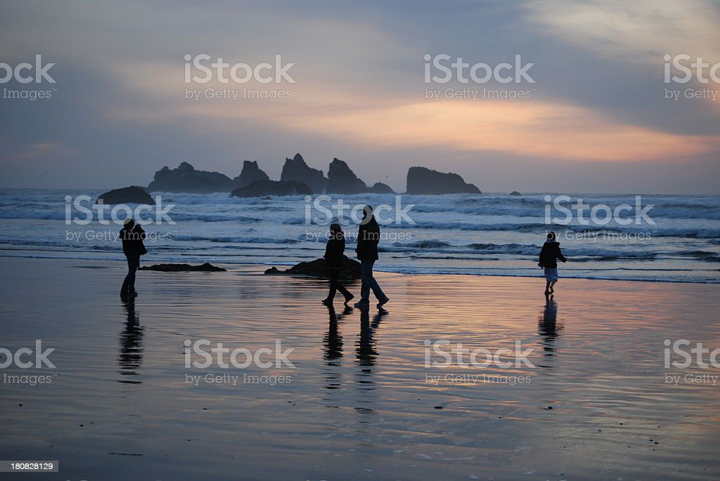 Family Enjoying Sunset at the Beach stock photo