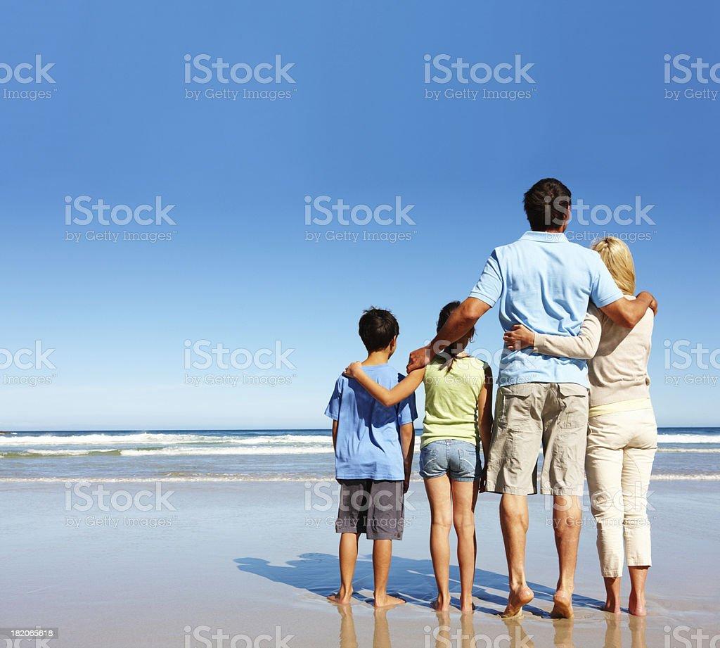 Family enjoying their vacation on the beach royalty-free stock photo