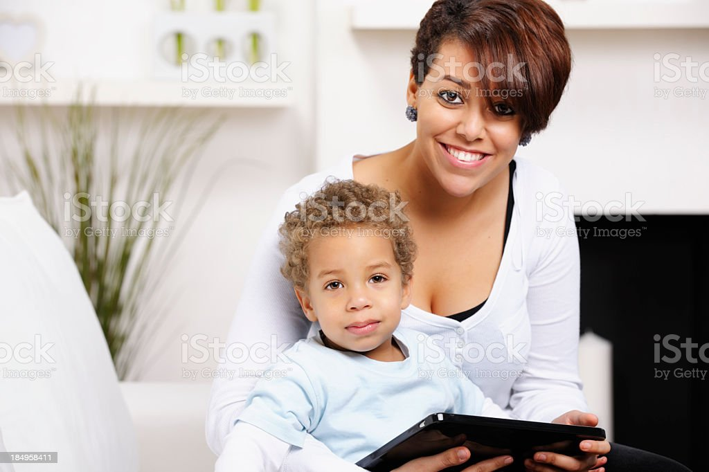 Family  Enjoying Time  In The Living Room Using Electronic Tablet royalty-free stock photo