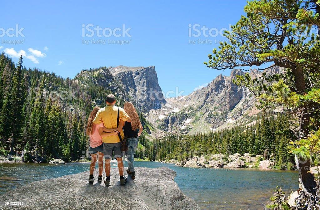 Family enjoying time together on hiking trip. stock photo
