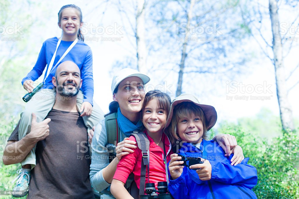 Family enjoying trekking trip. stock photo