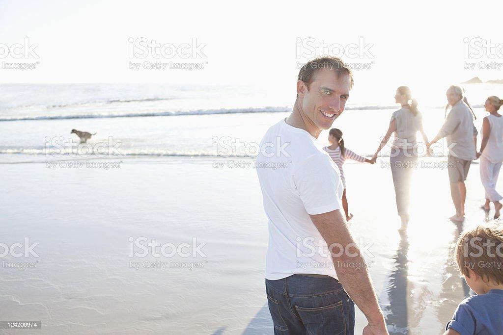 Family enjoying vacation on beach royalty-free stock photo