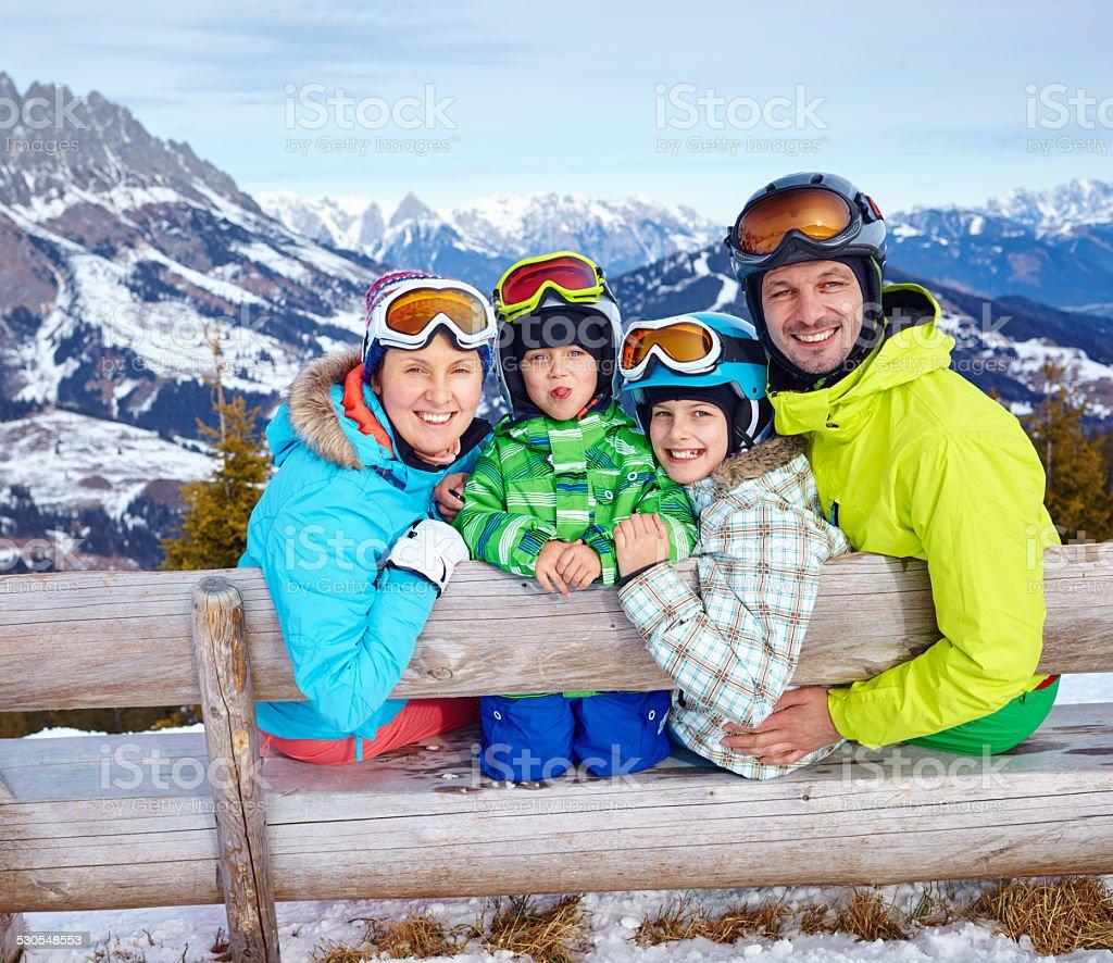 Family enjoying winter vacations. stock photo
