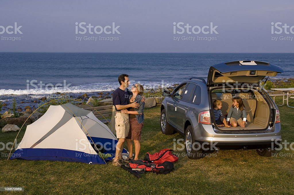 Family Enjoys New Sport Utility Vehicle and Camping stock photo