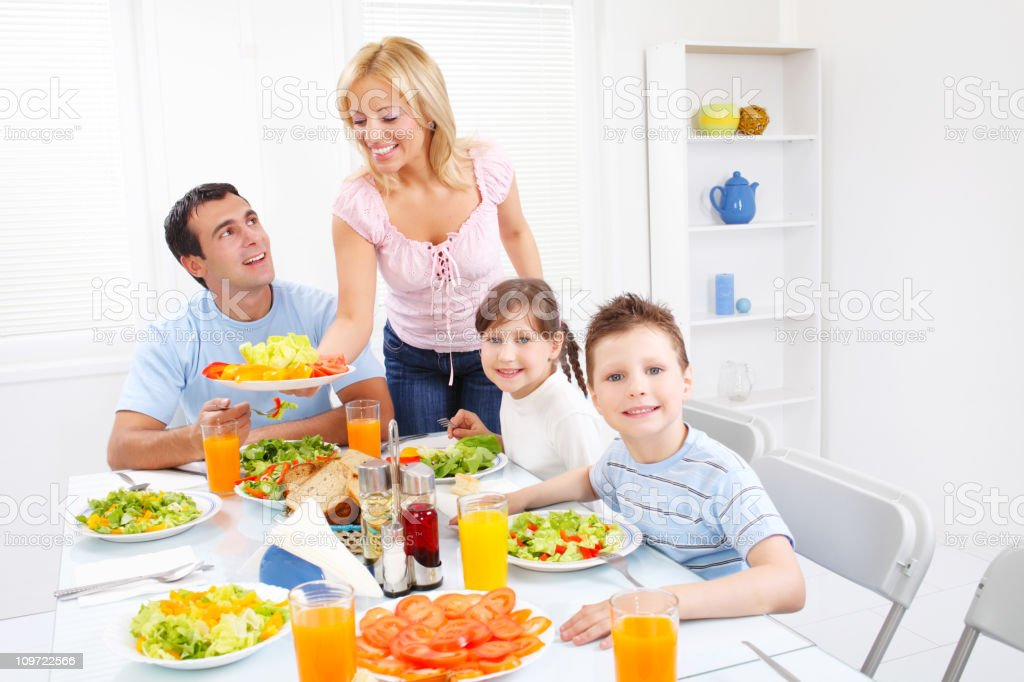 Family enjoys the meal-lunch together royalty-free stock photo