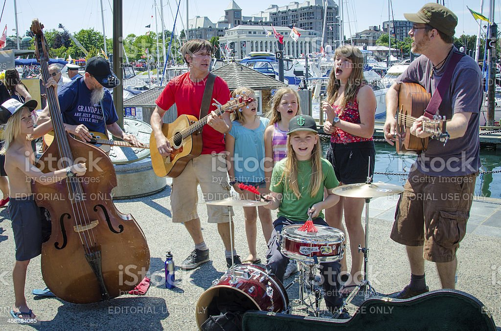 Family entertains the crowds on Canada Day royalty-free stock photo