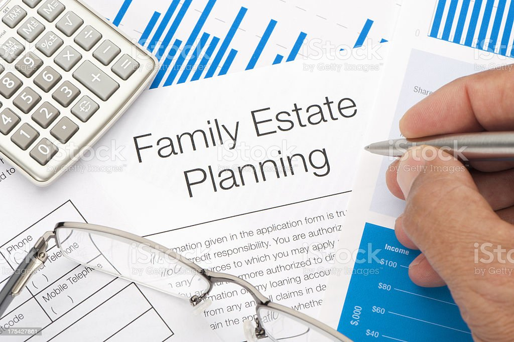Family Estate planning document with writing hand stock photo