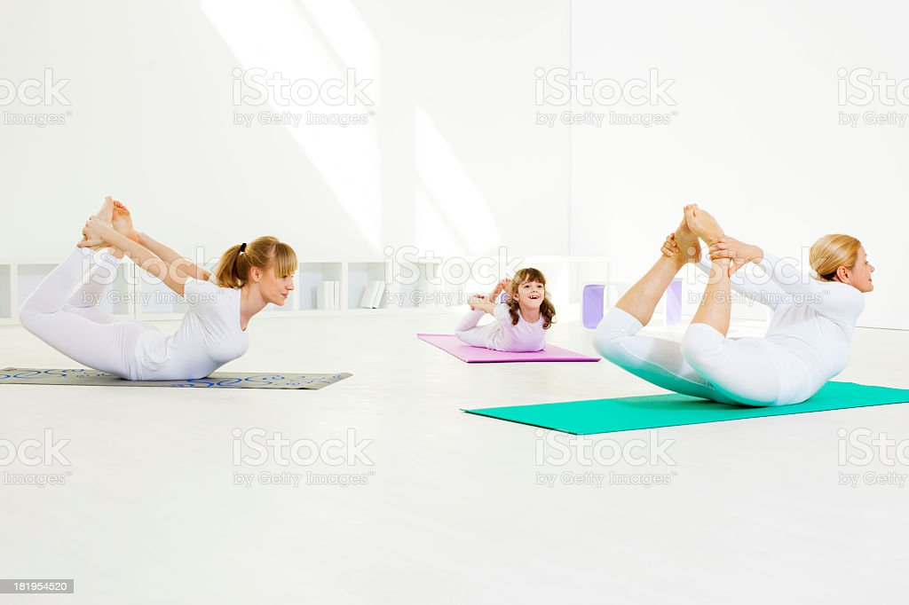 Family Exercise Yoga At Home. royalty-free stock photo