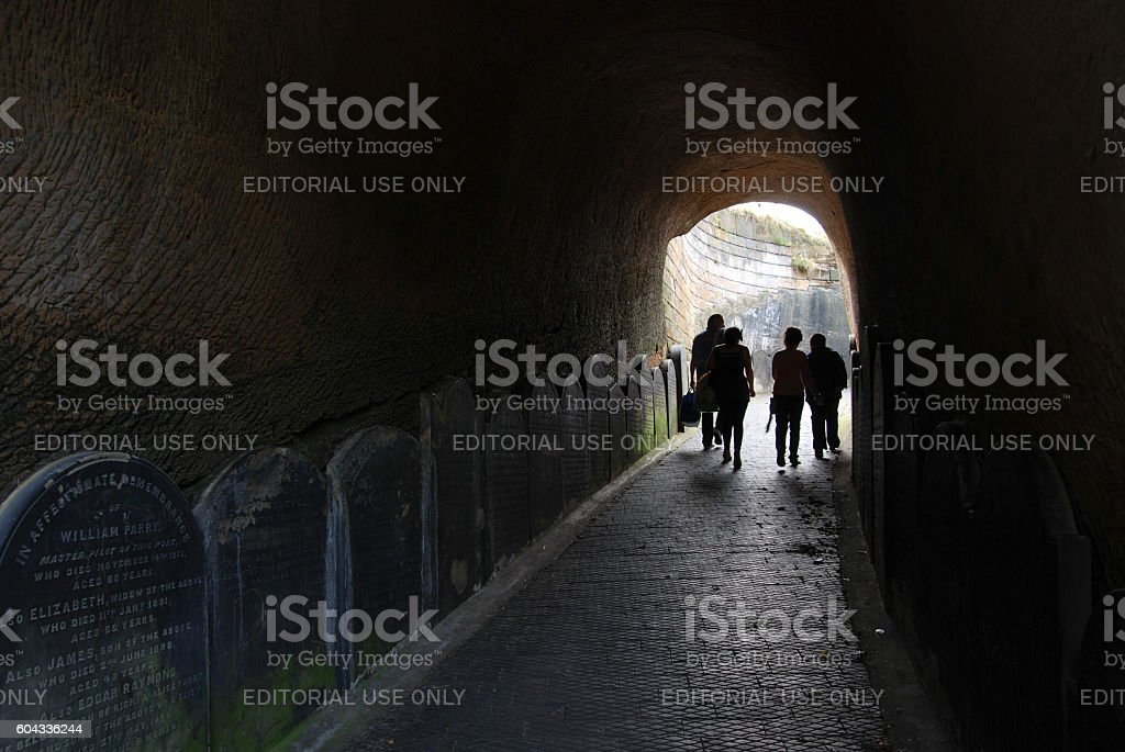 Family exiting tunnel from St James Cemetery to Liverpool Cathedral stock photo