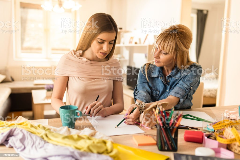 Family fashion designers working on new ideas at home. stock photo