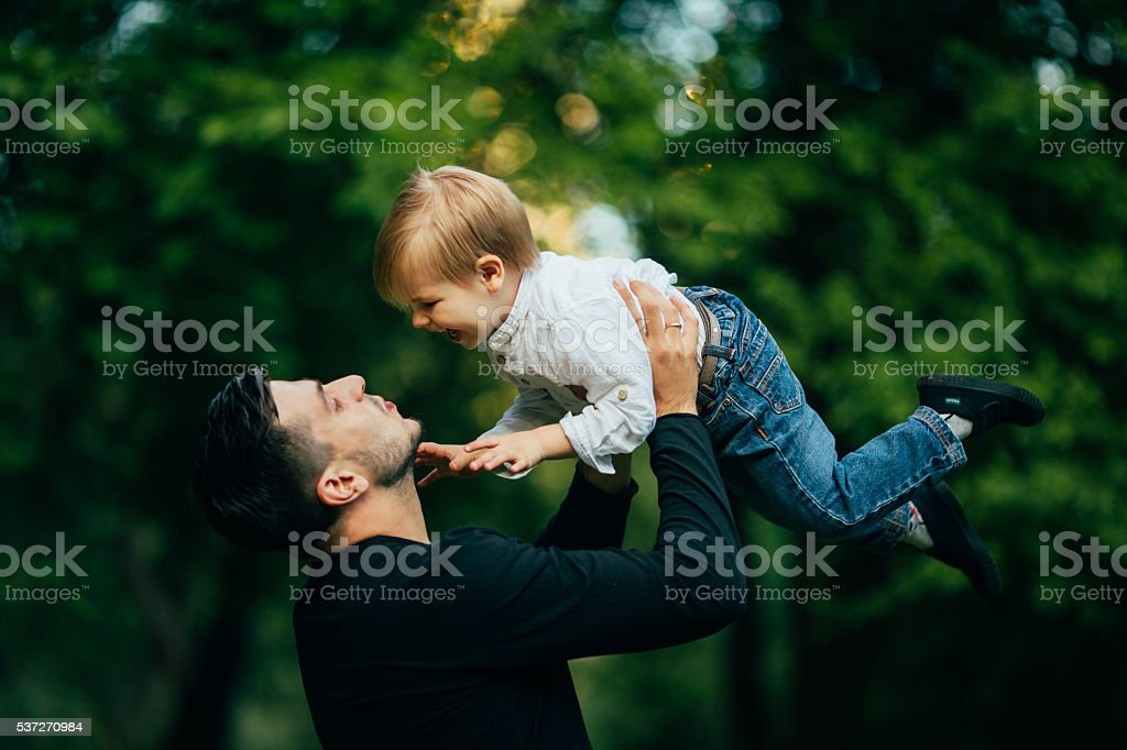 Family - father and his son up in the air stock photo