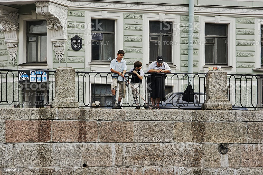 Family Fishing, Neva River, St. Petersburg, Russia royalty-free stock photo