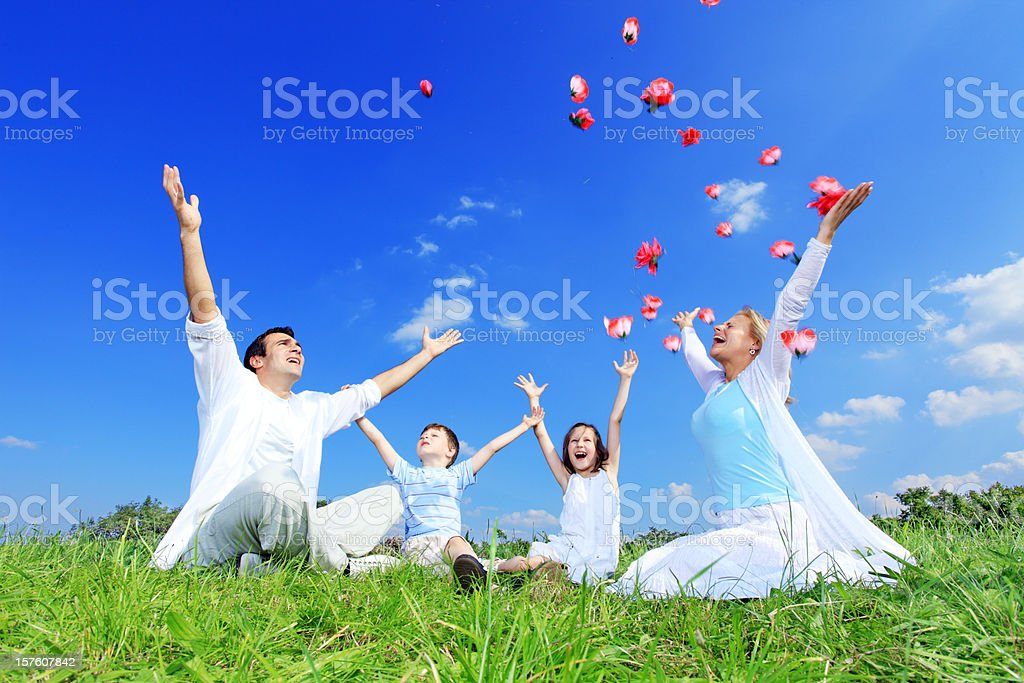 Family fling a flowers against the blue sky royalty-free stock photo
