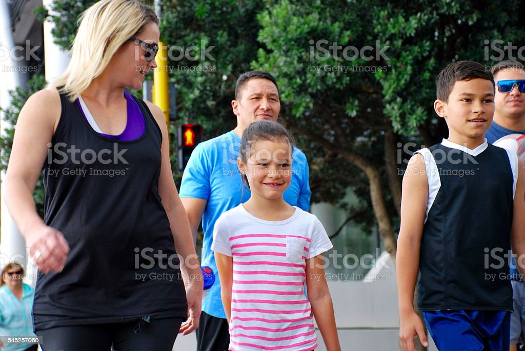 Family Friends walking in Urban Scene stock photo