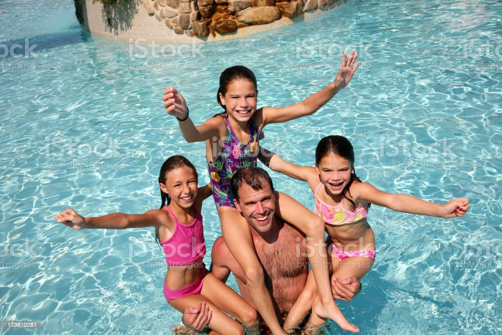 Family fun vacation in Swimming Pool stock photo