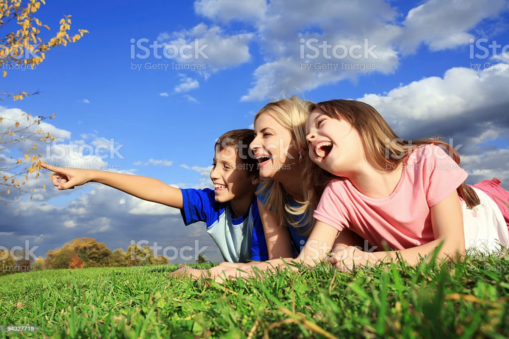 Family funning on grass. royalty-free stock photo