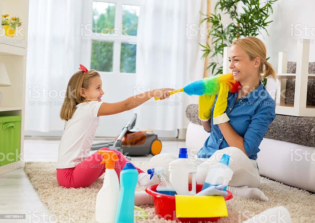 Family funny moments when cleaning home stock photo