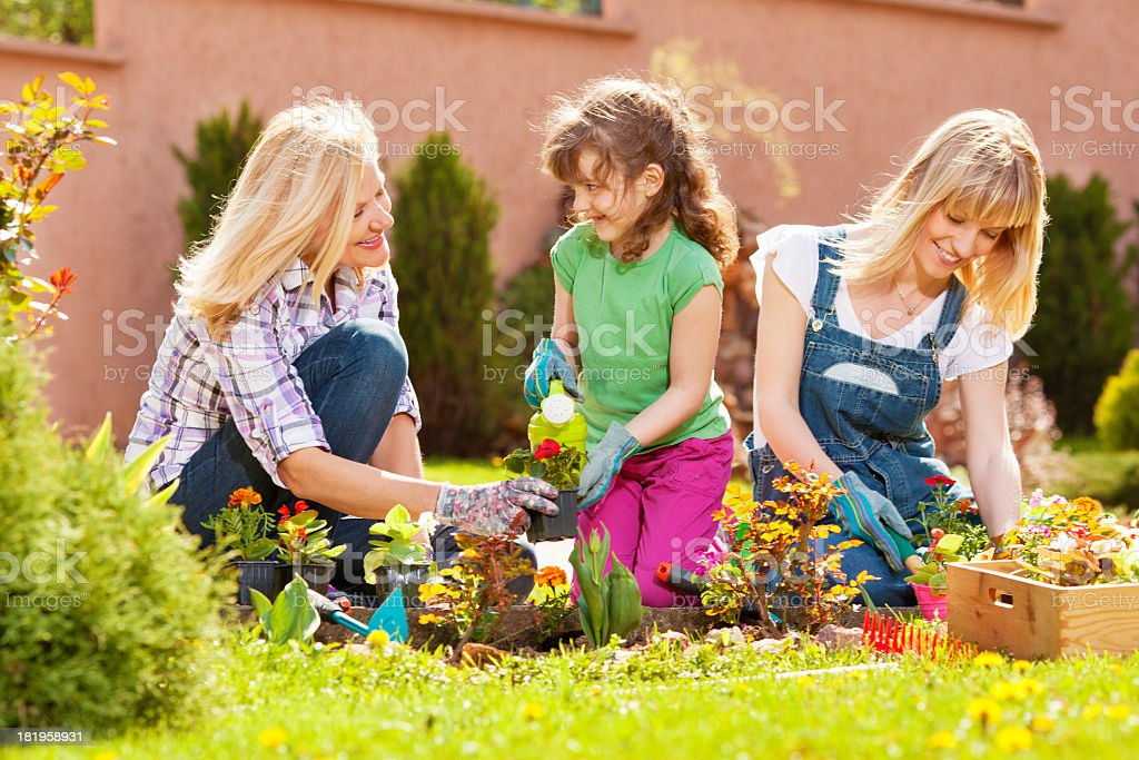 Family Gardening Together Outdoors. royalty-free stock photo