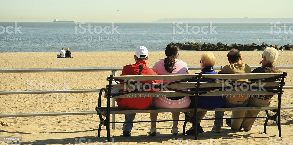 Family Gathering on the bench stock photo