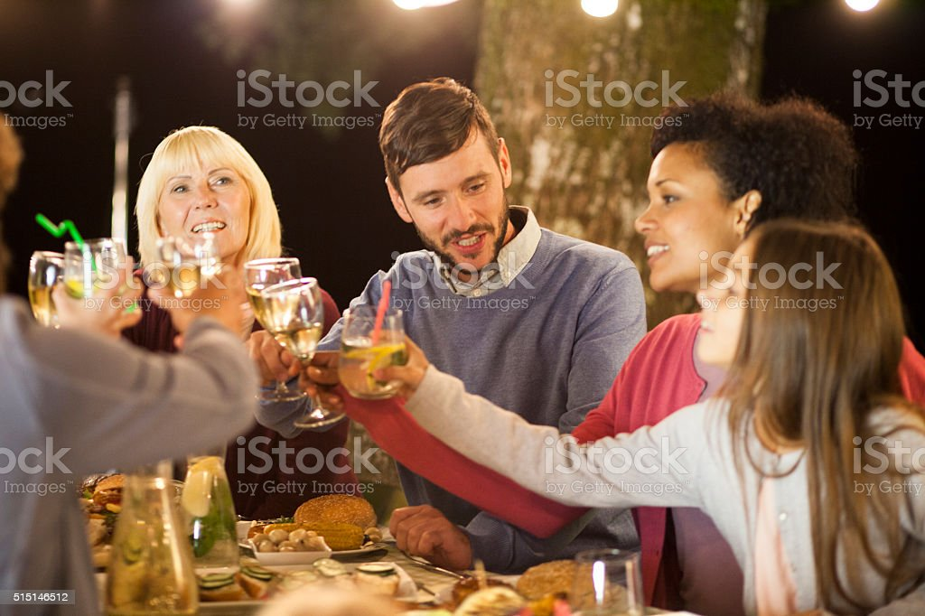 Family get together evening party in nature stock photo