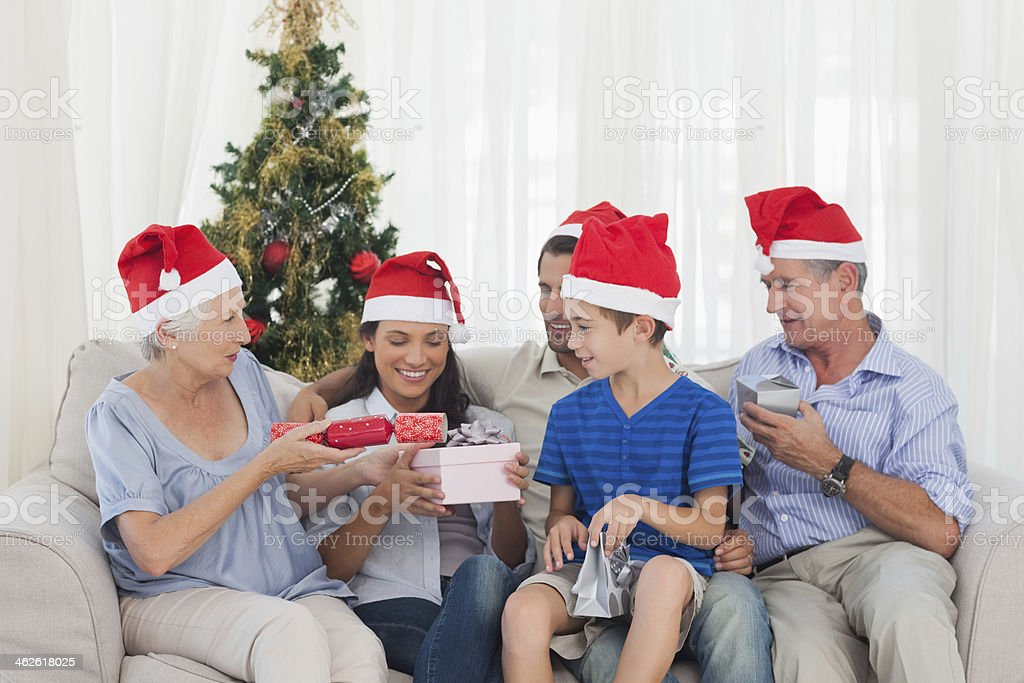 Family giving christmas gifts to each other royalty-free stock photo