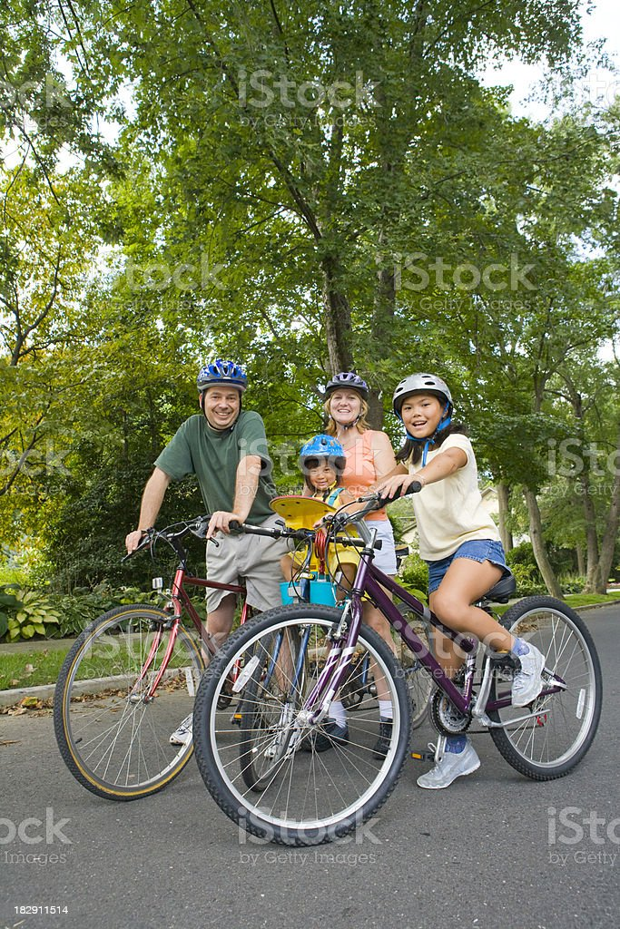 Family going for a bike ride stock photo