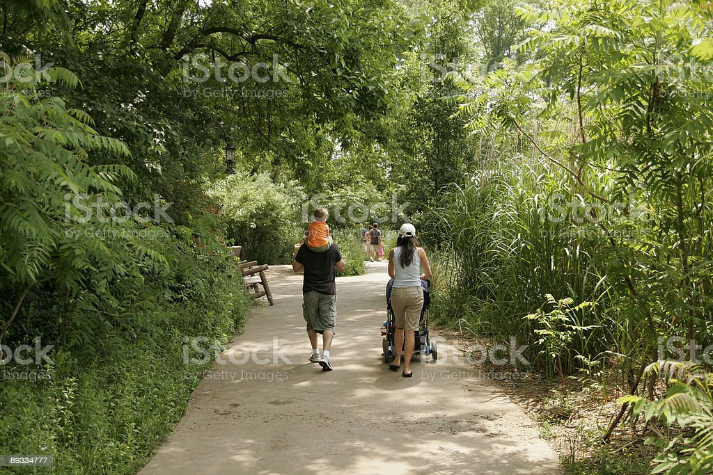 Family going for a walk at the zoo royalty-free stock photo