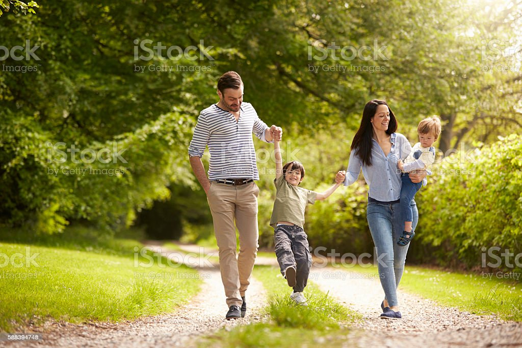 Family Going For Walk In Summer Countryside stock photo