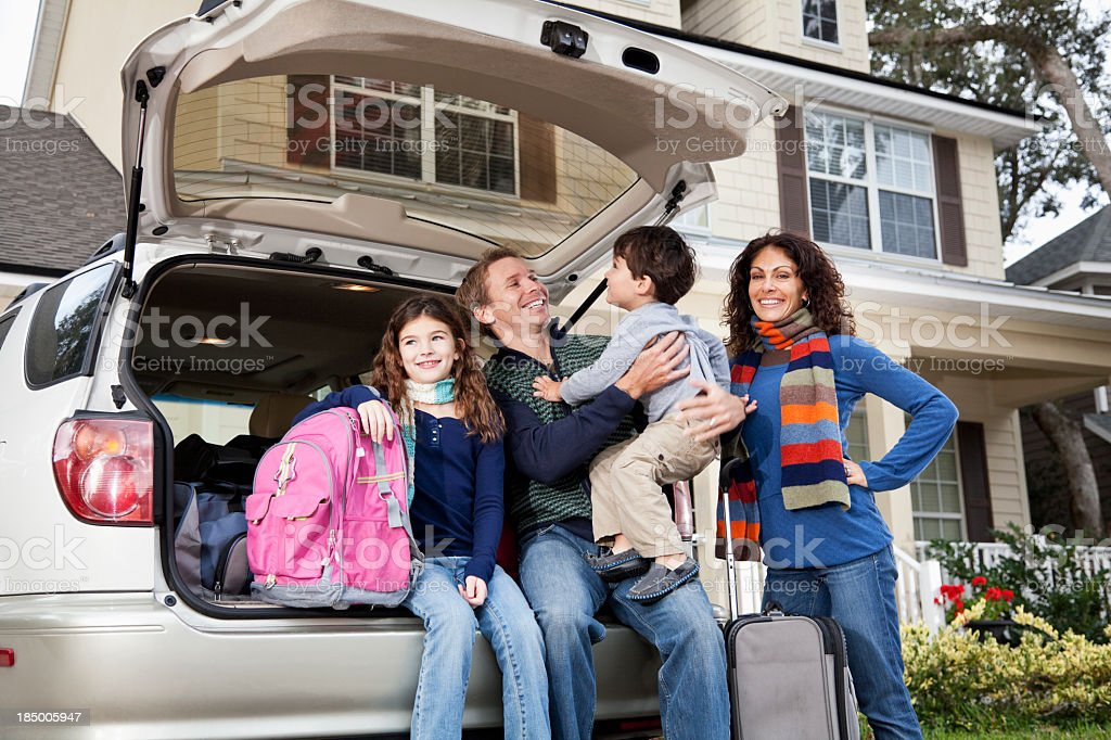 Family going on road trip with car and luggage stock photo