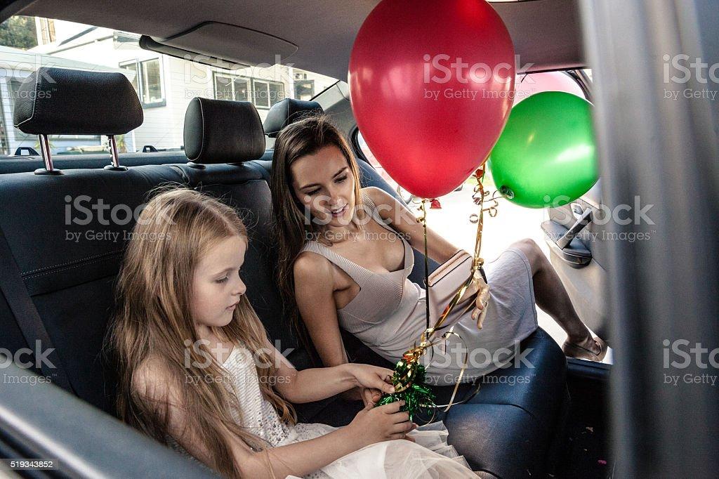 Family going to celebrate a birthday party stock photo