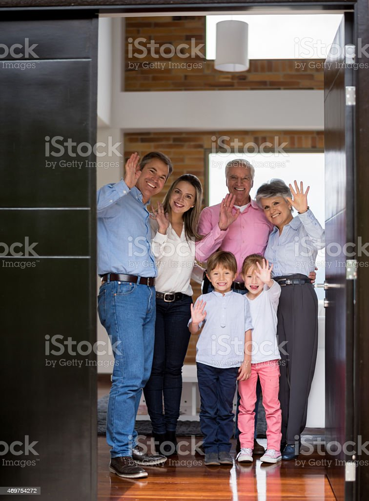 Family greeting at the door stock photo